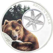 Brown Bear 1oz silver Tokelau coin with hand-woven filigree 'snowflake'.