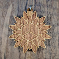 Cube Lotus pendant on Cherry Hardwood