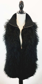 "Tibetan Lamb Vest with a Knit back Size: One size fits most – 35"" Chest, 36"" waist, 38"" hips, 26"" from shoulder to hem. Color: black Details: Tibetan Lamb Vest with a Knit back with 2 front pockets, with front zipper.  Full satin lining.  Relaxed fitting.  Fur origin: China.  Made in China.  100% real Tibetan lamb fur trim.  Knit back 100% acrylic."