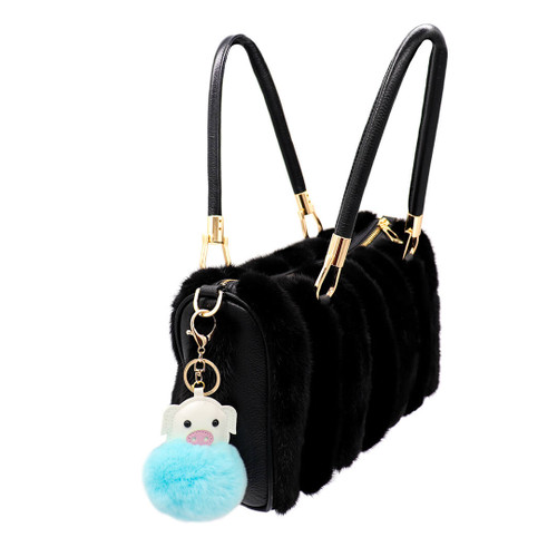 Rex Rabbit Fur pig keychain blue on bag