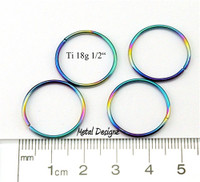 "Rainbowed Anodized Titanium Jump Rings 18 Gauge 1/2"" id."