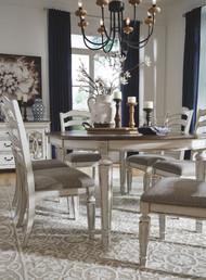 Realyn Chipped White 7 Pc. Oval Extension Table & 6 Upholstered Side Chairs