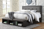 Hyndell Dark Brown Queen Upholstered Panel Bed with Storage