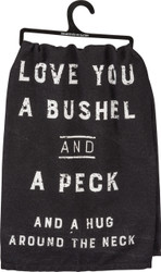 Black dish towel with white distressed lettering: Love You A Bushel And A Peck And A Hug Around The Neck Primitives By Kathy Item #30353