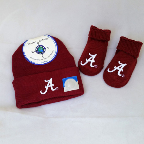 """Crimson Tide Newborn Gift Set includes knit cap and booties with script """"A"""" logo"""