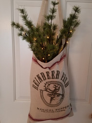 Reindeer feed bag and one pre-lit pine twig stem. Instant farmhouse charm!