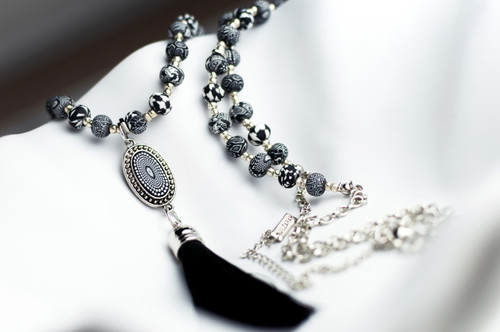 Jilzarah's classic black and white clay beads on a long tassel necklace