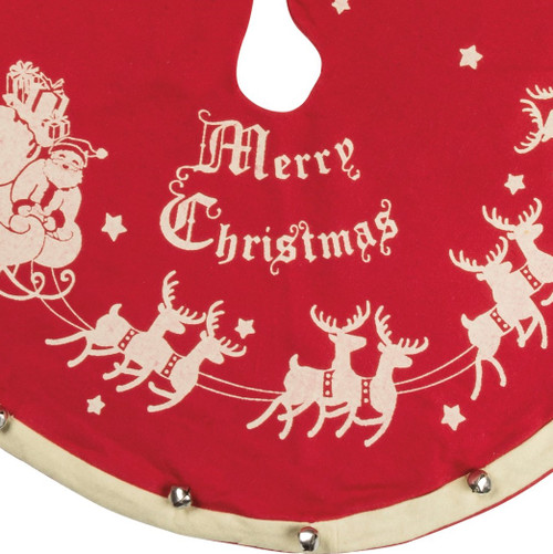 Jingle all the way! Christmas tree skirt features metal jingle bells with Merry Christmas Santa, sleigh and reindeer.