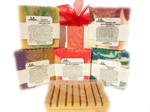 HANDMADE SOAPS: Our all natural soap is made with love.  We chose organic ingredients that are balanced for their cleansing and moisturizing properties.  This cold pressed soap features a unique block design; each bar has a slightly different design.  Choose the fragrant that best suits your taste.  Directions:  Wet a wash cloth and rub soap together until it lathers, then apply to your body for a clean, moisturizing, and refreshing aroma.  FOR EXTERNAL USE ONLY.  Ingredients: organic unrefined coconut oil, pure olive oil, organic palm oil, pure castor oil, organic cocoa butter, distilled water, sodium hydroxide (lye), fragrance oils, essential oils, and color micas. Some soaps also include shea butter, apricot kernel oil, palm oil, avocado oil, neem seed oil, goats milk, butter milk, beer, pure cacao, oatmeal, lavender petals, chamomile flakes, crushed almonds, green tea powder, green tea leaves, and seaweed powder  SELECT THE SCENT TO SEE ANY ADDITIONAL  INGREDIENTS OR ADDITIVES USED FOR OUR HANDMADE SOAPS.  Size:  Approximately 7 oz depending upon the cut of the soap.  Customers:  Pregnant women should consult their physician before using any products containing certain essential oils. These are natural soaps, which are cured a minimum of six weeks before they are sold. Designs vary by bar. Additional soaps scents become available every two months.  Also see our novelty bars; 5-7 oz.  Soap dish (not pictured); or our Cleansing Soaps.  Soap dish may be purchased separately in Accessories.  Each soap is beautifully packaged. For a lasting bar, keep in a dry cool place.  Do not leave sitting in water.  Made in Bayside, NY
