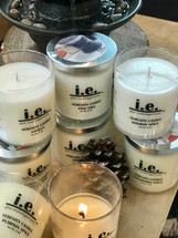 Our fragrant candles—when lit—provide a scintillating aroma while setting the mood for a relaxing environment that is perfect for relieving stress after a long day, enjoying a quiet moment, meditating, or while enjoying a soothing bath.  Each candle is made in the natural color without any embellishment, unless otherwise indicated by your selections.   Directions:  Carefully light the wick of the candle with a match or a lighter.  Allow candle to burn to the edges of the candle for a continuous even burn.  Cut the wick down (between burns) to less than a half of an inch to keep the flame low.  Always trim the wick prior to re-lighting the candle.   Ingredients:  Each candle is made with soy wax and essential oils/fragrance oils.  Some candles may have vegetable wax, beeswax, additive coloring and embellishments such as sea shells and waterfall rocks.  Size:  9 oz. glass jars in a variety of fragrances.  Lid covers may vary between black, silver (pictured), and clear glass.   Also available in 16 oz. (link here)  Customers:  Candles should only be burned for up-to two hours at a time.  Trim the wick prior to re-lighting the candle.  Burn on heat-resistant surfaces.  CAUTION:  Always use caution when lighting a candle.  DO NOT keep candles lit that are unattended.  Keep out of reach of children and away from pets.  Keep away from items that may catch fire.  Keep clear of drafty areas.