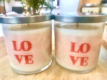 Say it with LOVE.  Express your LOVE for the special someone in your life with these limited edition LOVE candles.  These fragrant Candles—when lit—provides a scintillating aroma while providing a relaxing environment for you to relieve stress.  Each is made with 100% soy, essential oils, and fragrance oils.   9 oz  Burn time 45-50 hours  CAUTION:  Candles should only be burned for up to two hours at a time.  Trim the wick prior to re-lighting the candle.  Burn on heat-resistant surfaces.  Always use caution when lighting a candle.  DO NOT keep candles lit that is unattended.  Keep out of reach of children and away from pets.  Keep away from items that may catch fire.  Keep clear of drafty areas.