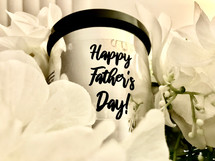 HAPPY FATHER'S DAY SCENTED CANDLE  Our fragrant candles—when lit—provide a scintillating aroma while setting the mood for a relaxing environment that is perfect for relieving stress after a long day, enjoying a quiet moment, meditating, or while enjoying a soothing bath.  Each candle is made in the natural color without any embellishment, unless otherwise indicated by your selections.   You may include a special message for the special dad in your life.    Directions:  Carefully light the wick of the candle with a match or a lighter.  Allow candle to burn to the edges of the candle for a continuous even burn.  Cut the wick down (between burns) to less than a half of an inch to keep the flame low.  Always trim the wick prior to re-lighting the candle.    Ingredients:  Each candle is hand poured with 100% soy wax, essential oils/fragrance oils, and cotton wicks.   Size:  9 oz. reusable glass jars in a variety of fragrances.  Lid covers may vary between black, silver (pictured), and clear glass.   Also available in 16 oz. (link here)  Burn time:  approximately 45-50 hours  Customers:  Candles should only be burned for up-to two hours at a time.  Trim the wick prior to re-lighting the candle.  Burn on heat-resistant surfaces.  CAUTION:  Always use caution when lighting a candle.  DO NOT keep candles lit that are unattended.  Keep out of reach of children and away from pets.  Keep away from items that may catch fire.  Keep clear of drafty areas.