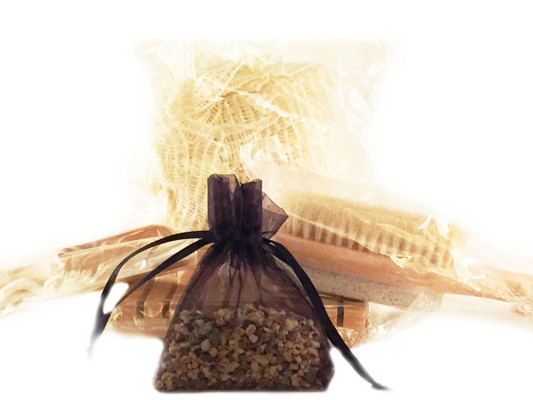 BATH ACCESSORIES SET:  This set is the perfect complement to your bathing enjoyment or to add to any gift.  The set includes:  one wooden soap dish with grooves; one small wooden scoop; one natural pumice brush; and one scented sachet in an organza bag.