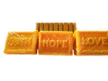 FAITH, HOPE, AND LOVE CLEANSING SOAPS GIFT SET IN SPA DAY CITRUS:  Enjoy three bars of this uplifting soap.  Ingredients:  This soap is made from a mango butter soap melt base, which is made from (Glycerin, Prop. Glycol, Coconut Oil, Triethanolamine, Sodium Cocoate, Sodium Myristate, Sodium Laurate, Sodium Stearate, Titanium Dioxide, Mango Butter, Sodium Laureth Sulfate, Purified Water) and clear soap melt base which is made from (Propylene Glycol, Sorbitol, Water, Sodium Laureth Sulfate, Sodium Palmitate, Sodium Myristate, Sodium Starate, Sodium Cocoyl Isethionate, Glycerine, Triethanolamine, Sodium Laurate).  In crafting this soap, we added fragrance and essential oils, organic unrefined coconut oil, tumeric powder, and sweet almond oil.  It is presented in our Faith, Hope, and Love block mold.  Size:  4.2 oz.