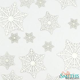 """Snow Crystals"" Paper Snowflake Cutouts"
