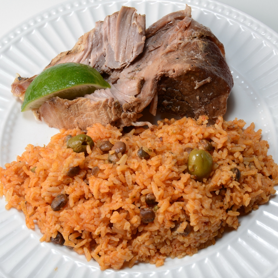 Lechon Asado served with arroz con gandules.