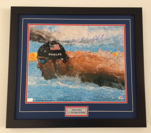Framed Michael Phelps picture is a great example of how to capture your memories. We can frame your 8x10, 11x14, 16x20, 18x24 or 24x36 sports images with or without nameplates!