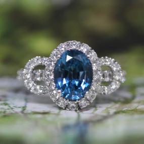 Halo Blue Topaz Ring
