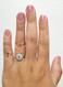 Round Halo Engagement Ring On Hand