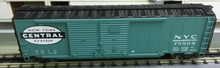 Lionel NYC 50' double door box car with auto rack load , 3 rail