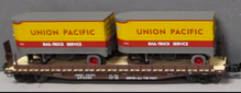Lionel  UP twin pup  trailers on 50'  wood deck flat car
