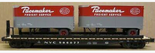 Lionel  NYC  twin pup  trailers on 50'  wood deck flat car