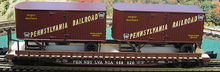 Lionel  PRR  twin pup  trailers on 50'  wood deck flat car