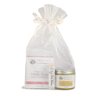 """Balancing kaolin rose clay works deep into the """"cracks"""" and pores of your face to cleanse and moisturize. Rosehip Seed Oil is rich in Vitamin C, helping to correct sun damage, scarring, fine lines/wrinkles, age spots and other minor skin imperfections. Uplifting palmarosa essential oil provides a foundation of hydration by naturally restoring and renewing dead skin cells."""