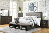 Hyndell Dark Brown 4 Pc. Dresser, Mirror & King Upholstered Panel Bed with Storage