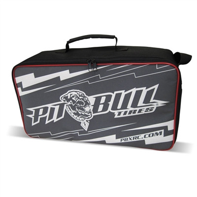 "For those of you who have a bunch of RC tires, wheels, tools and accessories (sound like you?), you NEED a PITBULL RC Tire Bag! ""Why"" you ask? Good question. Because they're really cool...yep...that's the reason and we're sticking to it. We have a two-tone bag (Black sides, Red trim with a Grey face and Pit Bull Lighting Logo in White Silkscreen). WE think it's pretty cool...but then again, it's our stuff...so, of course we like it. Tough Zippers, insulated housing, inner-corrugated plastic support, complete open top, a zipper pocket on the side, an adjustable shoulder strap and a carry handle...all in a nice-sized carry case. Our multi-purpose bag will make you look like a champ no matter what tire/wheel combo you run...but, of course we hope you're running Pit Bulls!!!!  What's included: Pit Bull Tire Bag (1 pc) Inner Corrugated Plastic Support (1 pc)"