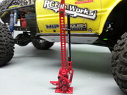 The one and only Hi-Lift jack, now offered in 1/10 scale size and fully functional down to the smallest details. There are imitators, but no one lives up to the one and only Hi-Lift. These have been Officially Licensed by the Hi-Lift Jack company and are only available from RC4WD and our Dealers.  Specifications: Red Paint Work Steel Standard Bar Top Clamp - Clevis Black Handle Handle Clip Spring Pitman Base Plate Total Height: 5.35in / 135.8mm Total Width: 1.45in / 36.8mm Base Plate Width: 1.1in / 28mm Base Plate Length: 0.63in / 16mm Handle Length: 2.95in / 75mm Handle OD: 0.16in / 3.95mm Steel Standard Bar Hole Width: 0.12in / 3mm Steel Standard Bar Hole Length: 0.08in / 2mm Steel Standard Bar Width: 0.28in / 7.2mm Weight: 1.59oz / 45g