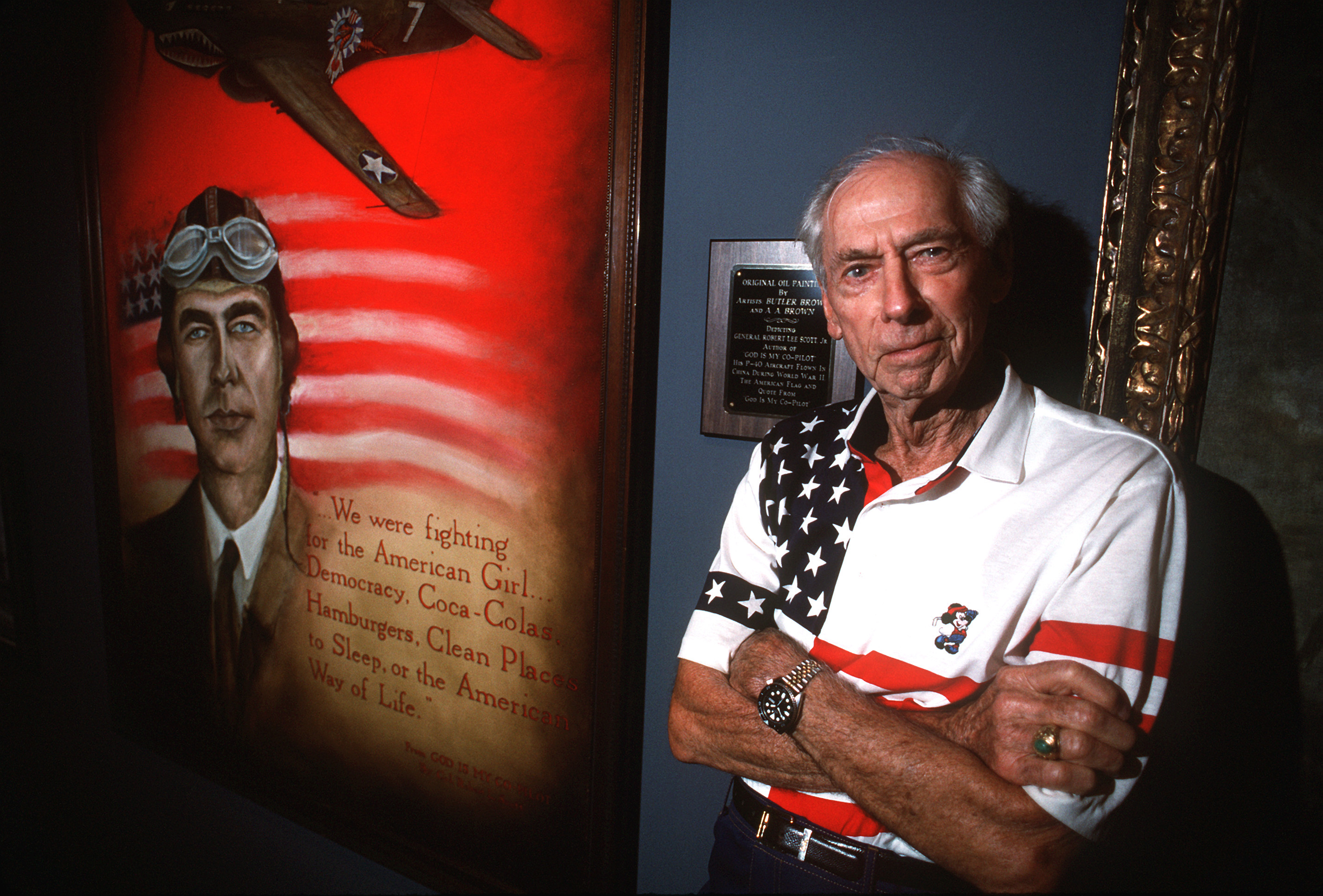 Retired Gen. Robert Lee Scott, Jr. pictured next to an original oil painting of himself.
