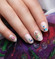 Fairest hand with Snow White nail polish and stickers