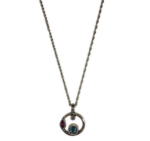 """Halley's Comet Necklace in Celebration by Patricia Locke Jewelry based in Mundelein, IL. Sterling silver chain with a Swarovski crystal set in sterling silver. 0.875"""" pendant on 18"""" chain."""