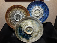 """This 13"""" Bread & Oil Plate is handmade by Campbell Pottery. This plate is available in Stellar Cream/Green/Blue and New Glaze/Dark. Please call for current photos of on-hand pieces. (970) 586-2151."""
