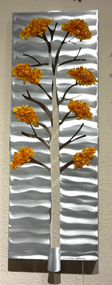 "Four Seasons - Fall, 10""x27"" by Sondra Gerber Hand brush aluminum and fused glass wall sculpture.  The use of positive and negative shapes within the intricate cut of the designs cast alluring shadows that interact with the piece itself."