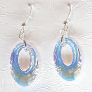 These Helios earrings in AB CRYSTAL from Snooty Jewelry are a delight to wear.  Wonderful sparkle shines from these 20 mm Swarovski Elements Crystals with sterling silver ear wires. This is a clear crystal which filters different colors depending on what colors are behind and around it.  Not all colors may be in stock at all times and some colors may only be available for purchase through the gallery. Please call for availability.