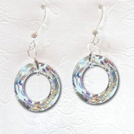 These Comic Ring earrings in AB CRYSTAL from Snooty Jewelry are a delight to wear.  Wonderful sparkle shines from these 14mm Swarovski Elements Crystals with sterling silver ear wires.   This is a clear crystal which filters different colors depending on what colors are behind and around it.  Some colors may only be available for purchase at the gallery.  Please call for availability.