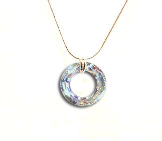 This Cosmic Ring Pendant in AB CRYSTAL from Snooty Jewelry is a delight to wear.  Bring on the sparkle with these 20mm Swarovski Elements Crystals with a sterling silver chain. This is a clear crystal which filters different colors depending on what colors are behind and around it.  Some colors may only be available for purchase at the gallery.  Please call for availability.