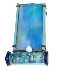 "The SURF kaleidoscope by Sue Rioux designs is 6"" x 3"" x 1"". The oil filled glass cell is easy to turn with its rounded edge square glass knobs. The cell holds small sea shells and bits of iridescent dichroic glass pieces, beads, wire and small baubles in Calming shades of aqua, turquoise and blues.  Please call to confirm availability and to purchase. 970-586-2151"