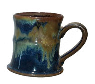 This is a 12oz. flared mug in GOLDSTONE from Cascadia Stoneware. Cascadia Stoneware is designed for everyday use.  Follow basic pottery care guidelines to ensure many years of use with stoneware pottery.
