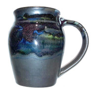 This is a 20oz. large round mug in BLACK GALAXY from Cascadia Stoneware. This glaze is a unique glaze combination of  microcrystalline and a glossy glaze.