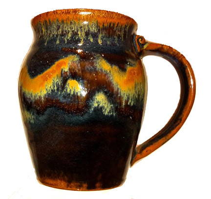 This is a 20oz. large round mug in GOLDSTONE from Cascadia Stoneware. Cascadia Stoneware is designed for everyday use.  Follow basic pottery care guidelines to ensure many years of use with stoneware pottery.
