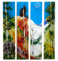 "Four Seasons - 4 piece set by Kathi D Dougherty portrays all the seasons in individual panels to create a dramatic scene in fused glass.  Each panel measures 6"" x 30""."