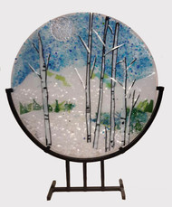 "The 'Winter Wonder' in a steel stand by Kathi D. Dougherty captures a fine winter day in the mountains. This 16"" fused glass round rests in a black coated steel stand for displaying.  Shop now or call to speak with a sales associate for additional assistance.  Earthwood Collections, 970.586.2151"