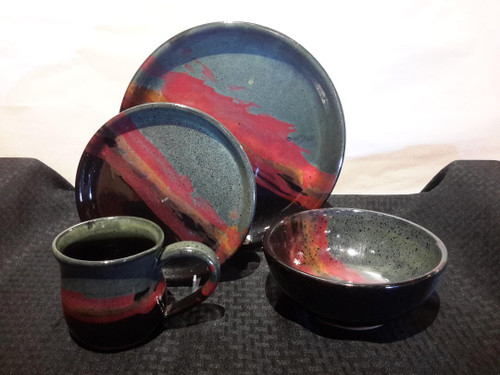 """Moonscape glaze place setting with wonderful multi layered glaze colors on fully functional stoneware that are dishwasher and microwave safe.  Set includes:11.25"""" Dinner plate, 8"""" Salad Plate, 16oz. soup bowl, 14oz. mug.  Always Azul pottery can be ordered in a variety of unique glaze colors like Azulscape, Moonscape, Seamist, Waterfall, and more. A variety of decorative design options can be applied like aspen leaves, dragonflies, moose, bear, wolf or full wrap designs like forest elk, mountain scenes and petroglyph ruins.  Call the gallery to discuss your preferred glaze color and design options. 970-586-2151"""