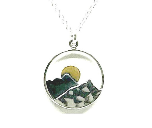 """A delightful 0.75"""" Mountain themed pendant necklace by Athena Designs. This pendant has an oxidized layer which creates depth and 14kt gold makes the moon glow over the peak. The sterling silver chain as a finished length of 15"""" with a 1.5"""" extender."""