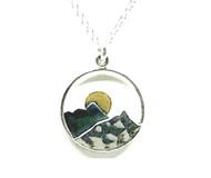 "A delightful 0.75"" Mountain themed pendant necklace by Athena Designs. This pendant has an oxidized layer which creates depth and 14kt gold makes the moon glow over the peak. The sterling silver chain as a finished length of 15"" with a 1.5"" extender."