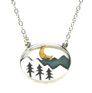 An 18mm x 20mm oval by Athena Designs displays a charming Mountain scene.