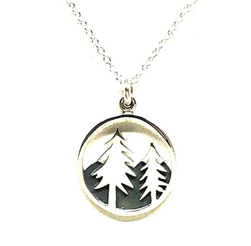 """This 15mm circle pendant by Athena Designs is a wonderful piece for any tree lover. Two tall pine trees adorn an oxidized mountain background. The sterling silver chain as a finished length of 17"""" with a 1"""" extender."""